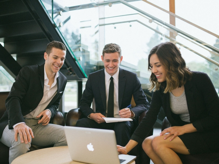 Business students using a laptop