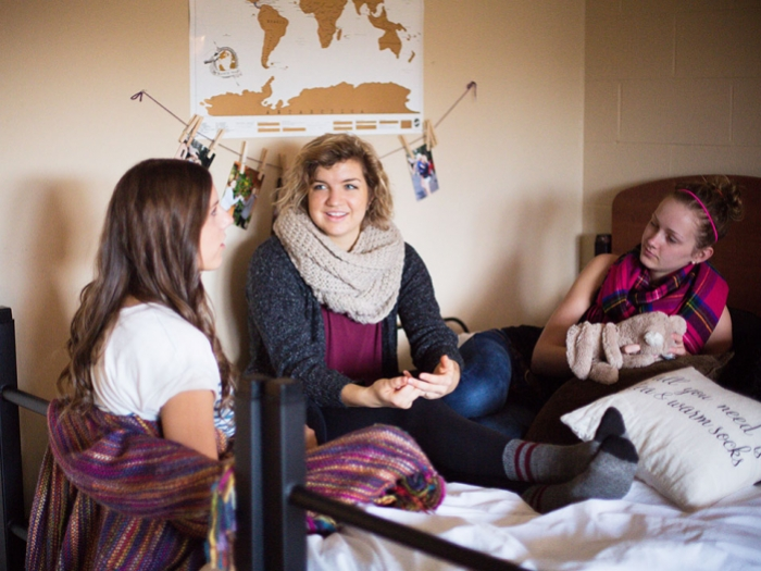 Female students on bed in dorm