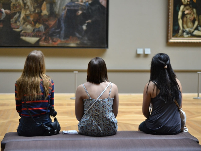 Students sitting in the Louvre