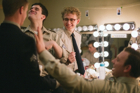 Male student actors preparing for show