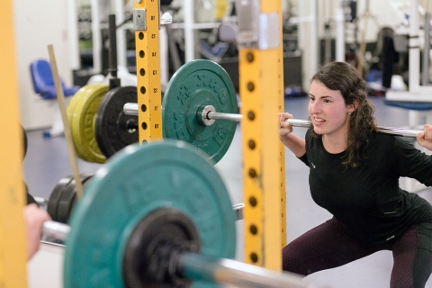 Female student lifting weights