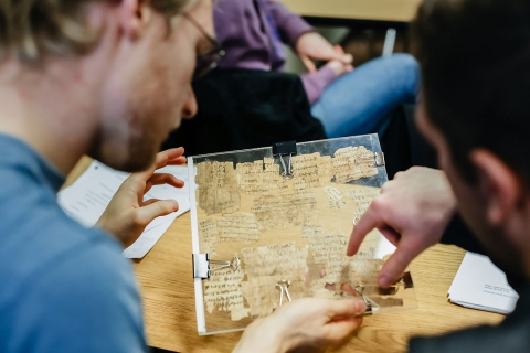 Students analyzing a scroll fragment