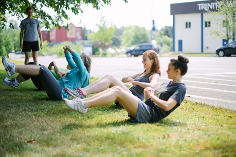 Female students exercising outside
